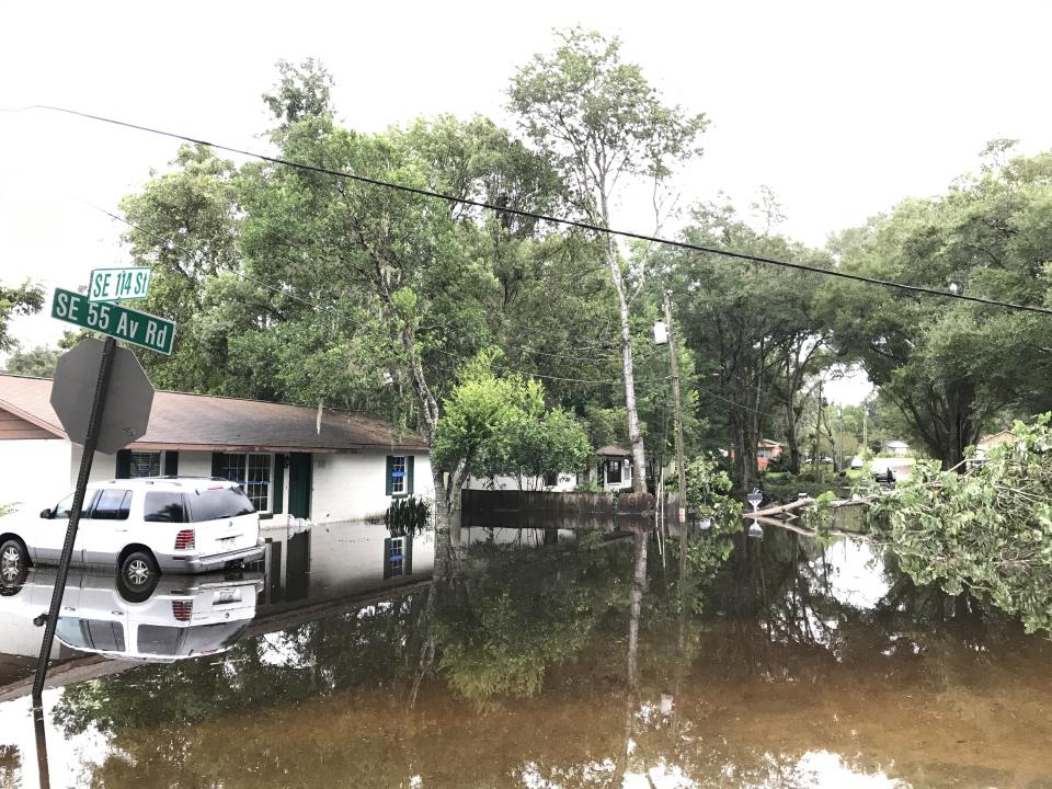 Flooded home and SUV